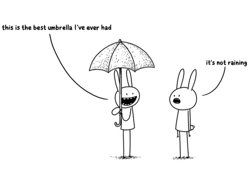 Two bunnies in the street, one holds an umbrella and explains how this is the best umbrella that he ever had, while the other replies that it is not even raining.